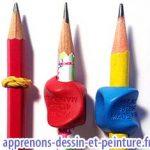 Crayon avec un élastique enroulé & deux autres enfilés dans un embout. Photo Richard Martens.